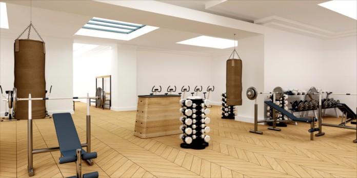 Ein leeres Fitnessstudio mit einem Sprungkasten in der Mitte