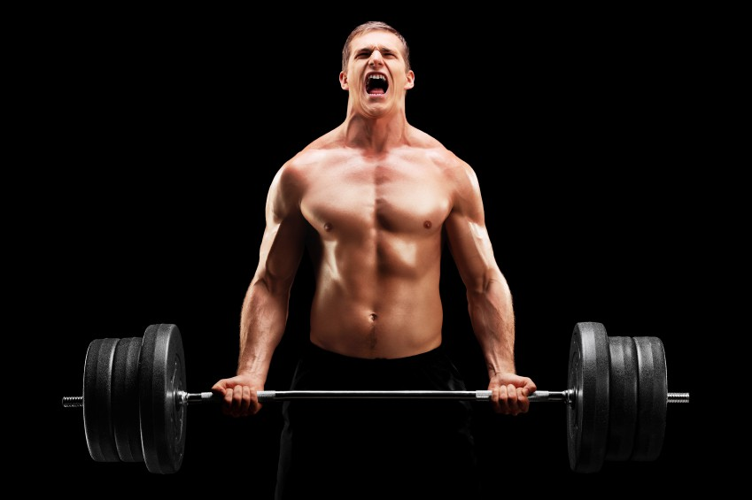 Young man lifting a heavy weight