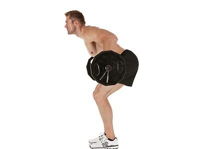 Sportler trainiert mit der Langhantel